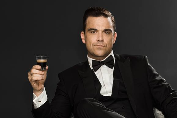 Robbie dropper musik: Det vil han nu! robbie williams