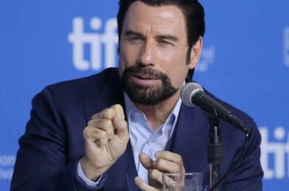 Homo-rygter: Travolta bryder tavshed! john travolta, hollywood